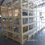 Helicopter fuselage protected with a skeleton crate departing on freighter service to Kenya